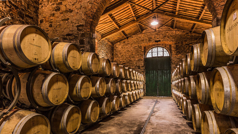 A summary of Tuscan winemaking - Wooden barrels, red bricks, beams and stones