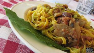 Fresh egg pasta tagliatelle with pork ragout, mushrooms and olives