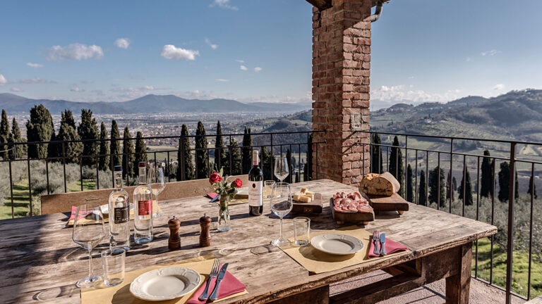 WS TOP 100 wine tasting with a wiev over Tuscany classic landscape